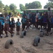 children-play-on-tyres-janet-school