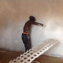 Alex painting the shop.