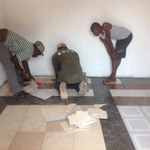 Laying tiles in shop
